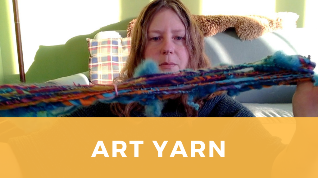 a woman holds a skein of textured multicolored art yarn
